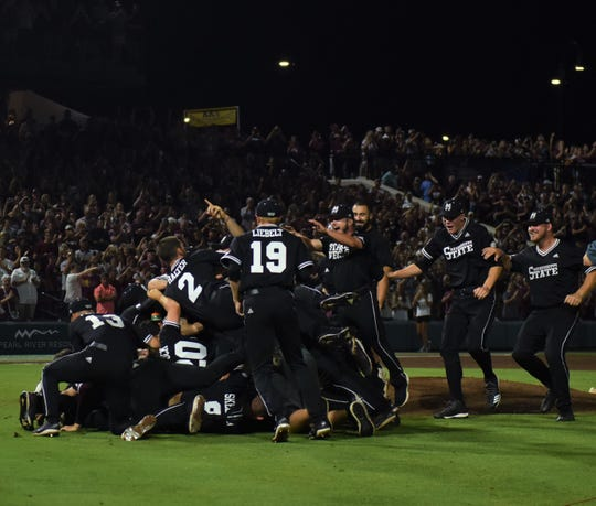 Mississippi State players dogpile after defeating Stanford 8-1 in Game 2 of the Super Regionals on Sunday, June 9, 2019, in Starkville.