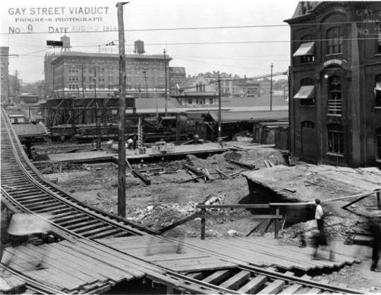 A 1919 photo shows the progress of the viaduct project raising Gay Street.