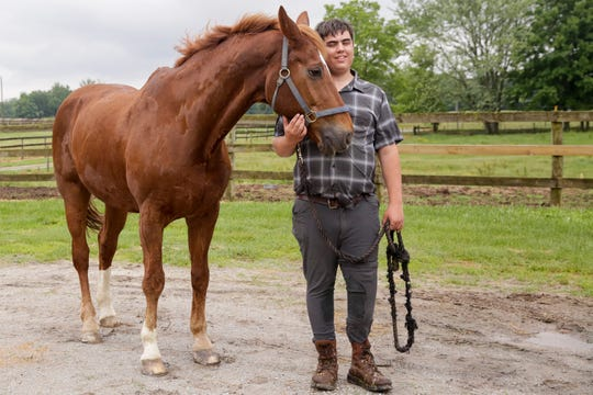 Peter Morrison pose with his horse, Rubin, Monday, June 10, 2019, at Forrest Hill Farm & Kaiser Dressage in Lafayette.
