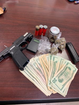 Cash, drugs, a handgun and paraphernalia Abbeville Police said it found while searching LaDaedick Narcisse's apartment.