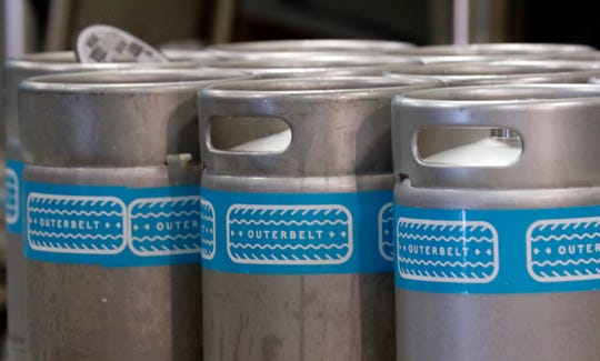 Kegs sit on a pallet at Outerbelt Brewery Monday morning, June 10, 2019, in Greenfield Township. The Brewery and Taproom opens to the public Saturday.
