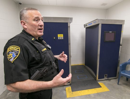 Standing in front of a body scanner Monday, June 10, 2019, Livingston County Sheriff's Dept. Lt. Jeff LeVeque discusses the use of such units at the county jail, as well as the advantages of the proposed upgrade to new equipment. The county bought the scanners in 2012 from the federal government after they were retired from airport use and were already years old.