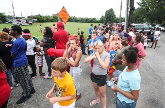 Hundreds of people waited for hours along Dr. W J Hodge Street near Broadway in West Louisville for the chance for a child to be one of 300 to receive a free pass to Kentucky Kingdom.  Tempers flared as people hopeful for a free season pass to Kentucky Kingdome waited outside to be one of first 300 to receive one. The Mardrian Group, a commercial construction group, sponsored the event. June 10, 2019.