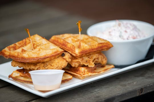 The chicken and waffle dish with cole slaw at Four Pegs on Goss Avenue. June 10, 2019