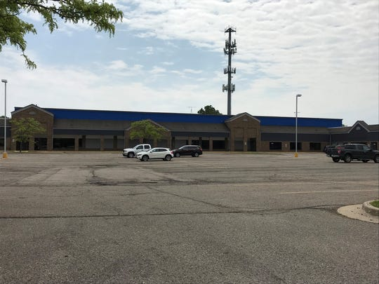 The former Metro Arena in Delta Township still exists within this strip mall area just east of the Lansing Mall. The address for the arena portion, shown here in blue, is 852 Elmwood Road.