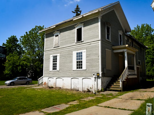The former home of Darius Moon, an early, prominent architect in Lansing.  Moon not only designed the double house on Martin Luther King Jr., he lived there. The home was damaged in a 2017 fire, and is facing possible demolition.