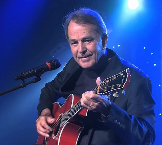Jim Stafford strums a tune at a recent performance.