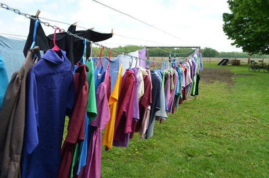 Even as Lovina has been busy sewing new dresses, she has also been keeping abreast of the family's weekly laundry — shown here drying on the clothesline.