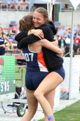 Kerrigan Myers leaps into Marisa Gwinner's arms at the 2018 state track and field meet.