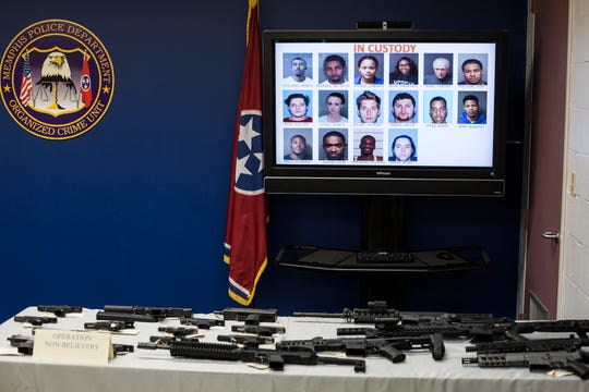 Multiple guns are seen on display during a press conference about two recent operations by MPD's Organized Crime Unit, June 10, 2019.