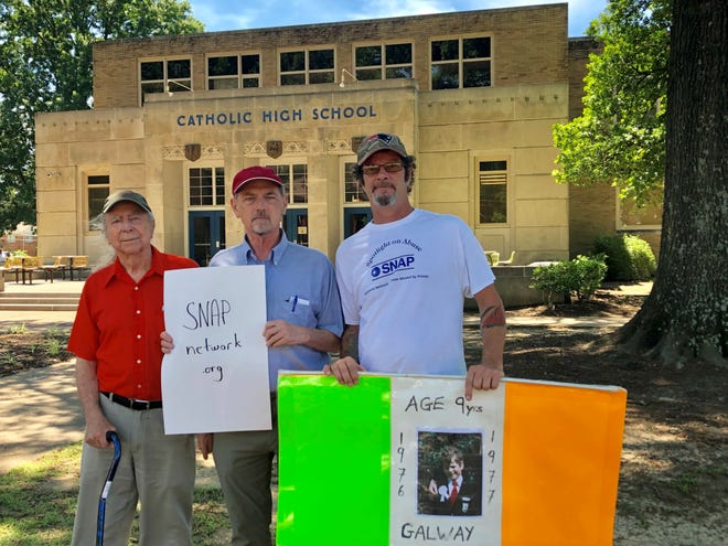 Ray Berthiaume, David Clohessy and Martin Prendergast, members of SNAP, the Survivors Network of those Abused by Priests, gather outside the Memphis Catholic High School on Monday.