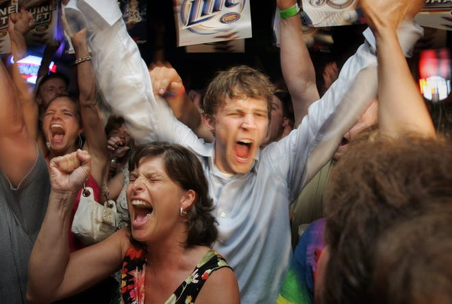 2005: Former Marquette basketball star Travis Diener reacts to his name being called during the NBA draft by the Orlando Magic. Diener was at the Press Box Tavern in Fond du Lac, where he joined family and friends to watch the draft.