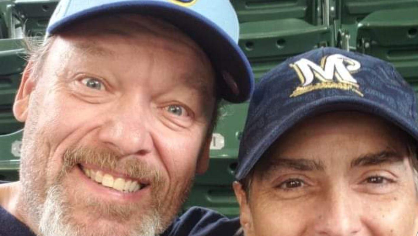 A retired math teacher from Burlington, Mark Gruber, walks away with a RAV4 after a well-placed Mike Moustakas home run Sunday