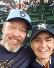 Mark and Dawn Gruber took a selfie in the second inning of Sunday's game. By the eighth, they would be owners of a new truck thanks to a well-placed Mike Moustakas home run.