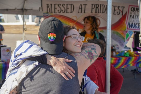 Rabbi Hannah Wallick of the Milwaukee Jewish Federation, gives a hug after performing a blessing during the PrideFest Milwaukee on June 7, 2019.