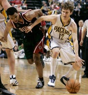 2008: Indiana Pacers guard Travis Diener, slips past Milwaukee Bucks guard Ramon Sessions as he drives to the basket during. Diener scored 18 points off the bench as the Pacers defeated the Bucks, 105-97.