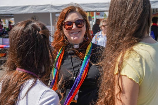 Kimberlee Tomczak Carlson of Unitarian Universalist Church offers a smile to those stopping by the blessings booth June 7 during Milwaukee PrideFest.