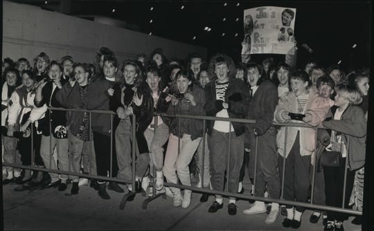 Young fans of New Kids on the Block crowd a barricade at the Bradley Center hoping to catch a glimpse of the fab five before the sold-out show on Jan. 10, 1990. This photo was on the front page of the Jan. 11, 1990, Milwaukee Sentinel.
