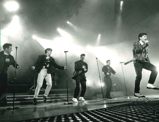 New Kids on the Block - from left, Joey McIntyre, Jonathan Knight, Donnie Wahlberg, Danny Wood and Jordan Knight - perform before a sold-out crowd at the Bradley Center on Jan. 10, 1990. This photo was published in the Jan. 11, 1990, Milwaukee Sentinel.