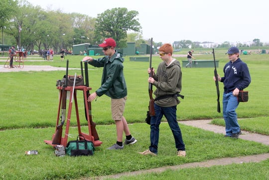 Members of the Lake Geneva Badger team store their unloaded shotguns between rounds at the 2019 Southeast Wisconsin Youth Trapshooting Conference Championships at Waukesha Gun Club.