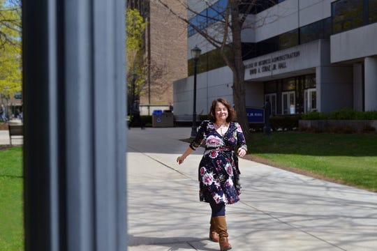 Kim Huettl, a graduate programs recruiter at Marquette University, walks on campus.