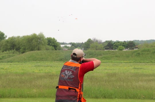 A member of the Lake Geneva Badger team breaks a target at the 2019 Southeast Wisconsin Youth Trapshooting Conference Championships at Waukesha Gun Club.