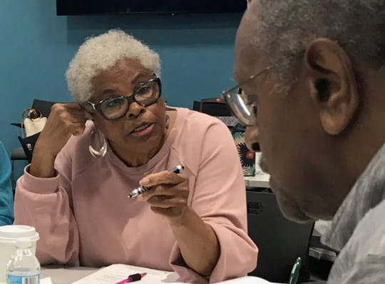 Bobby Thompson, left, and James Kimble discuss the future of Milwaukee County senior centers during a meeting at the United Way of Greater Milwaukee & Waukesha County.