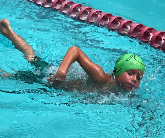 Mountain Home Hurricane swimmer J.W. Bailey competes at Paragould on Saturday.