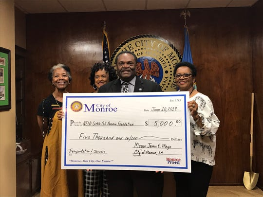 Northeast Louisiana Sickle Cell Anemia Board Member Pamela Higgins-Saulsberry, Executive Director Pauline Clark and Advisory Board Member Pauline Clark accept a $5,000 check for the NELA Sickle Cell Anemia Foundation from Mayor Jamie Mayo. The check was presented on behalf of the city and the Monroe City Council.