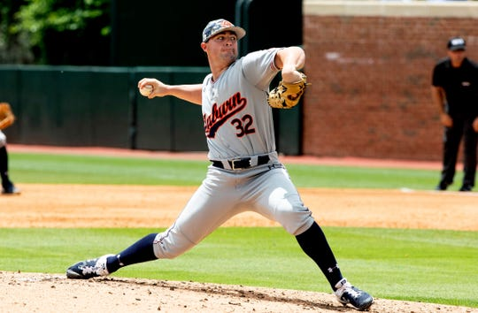 Auburn's Tanner Burns (32) pitches during an NCAA college super regional baseball game against North Carolina in Chapel Hill, N.C., Monday, June 10, 2019. (AP Photo/Ben McKeown)
