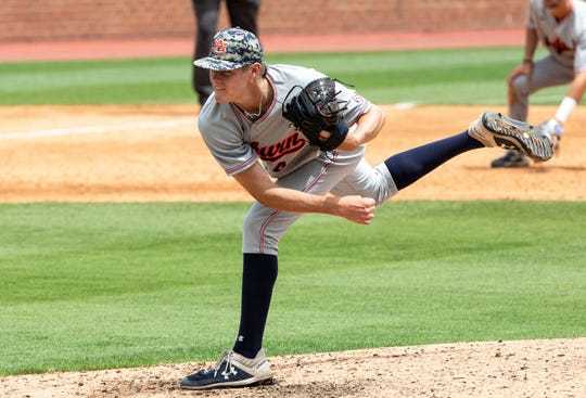 Auburn's Richard Fitts (43) pitches during an NCAA college super regional baseball game against North Carolina in Chapel Hill, N.C., Monday, June 10, 2019. (AP Photo/Ben McKeown)