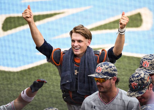 Auburn catcher Matt Scheffler (6) celebrates during the first inning of a Super Regional game against North Carolina on Monday, June 10, 2019, in Chapel Hill, NC.