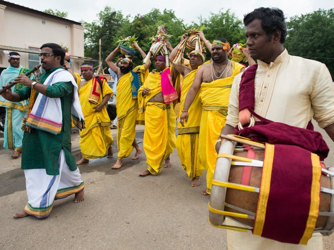 Hindu priests walk around the temple during the Pran Pratistha ceremony at the new Hindu Temple of Montgomery in Pike Road, Ala., on Sunday.