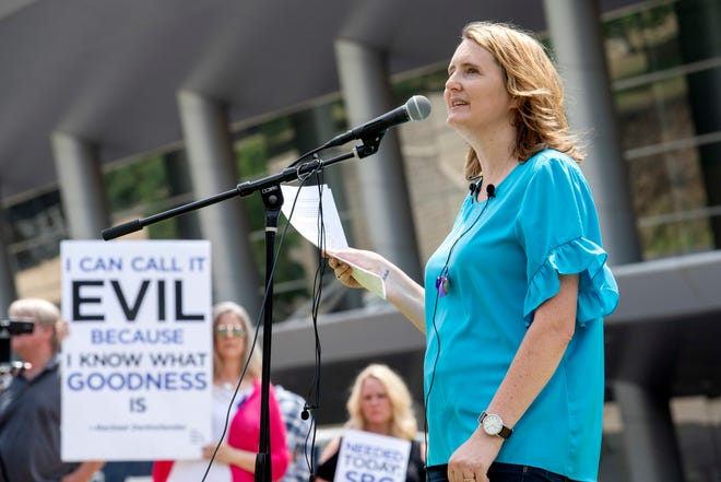 In this Tuesday, June 12, 2018 file photo, rape survivor and abuse victim advocate Mary DeMuth speaks during a rally protesting the Southern Baptist Convention's treatment of women outside the convention's annual meeting at the Kay Bailey Hutchison Convention Center in Dallas. O