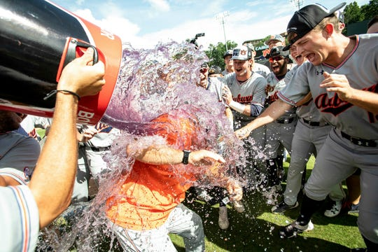 Auburn head coach Butch Thompson is doused as his team celebrates their victory over North Carolina in a super regional in Chapel Hill, N.C., Monday, June 10, 2019.