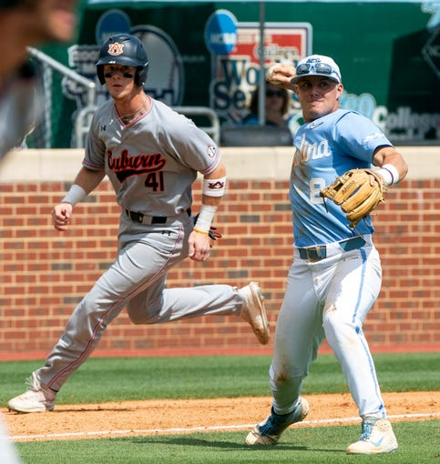 North Carolina's Ike Freeman (8) throws as Auburn's Steven Williams (41) rounds third base during an NCAA college super regional baseball game in Chapel Hill, N.C., Monday, June 10, 2019. (AP Photo/Ben McKeown)