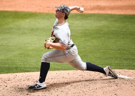 Auburn's Tanner Burns (32) pitches against North Carolina on Monday, June 10, 2019, in Chapel Hill, NC.