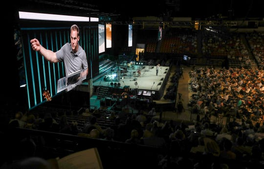 David Platt, former president of the International Mission Board and a current pastor at McLean Bible Church in Virginia, speaks at the Pastor's Conference at the Southern Baptist Convention on Monday.