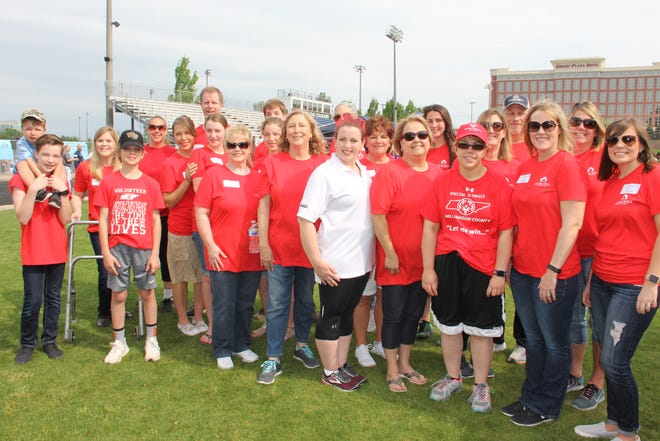 A team from Churchill Mortgage Brentwood volunteers at the Special Olympics Summer Games in 2018.