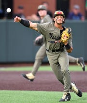 Vanderbilt third baseman Austin Martin throws out a Duke runner at first during the NCAA Division I Super Regionals at Hawkins Field, Sunday, June 9, 2019, in Nashville, Tenn.