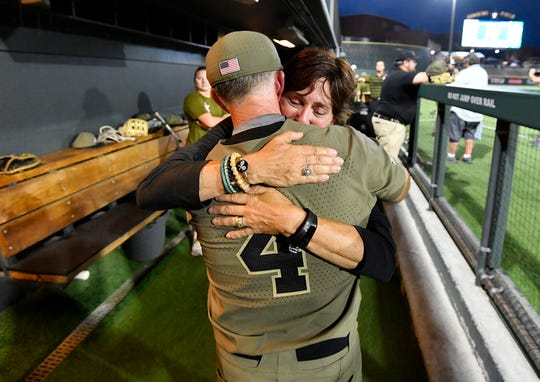 Vanderbilt head coach Tim Corbin is hugged by his wife, Maggie, after the team beat Duke to win the NCAA Division I Baseball Super Regionals at Hawkins Field Sunday, June 9, 2019, in Nashville, Tenn.