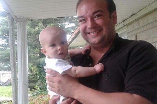 Steven Carver holding Steven Pierce