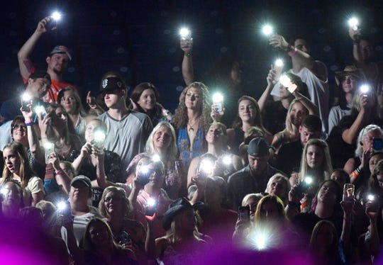 Fans listen to Chris Janson perform during the 2019 CMA Fest on June 9.