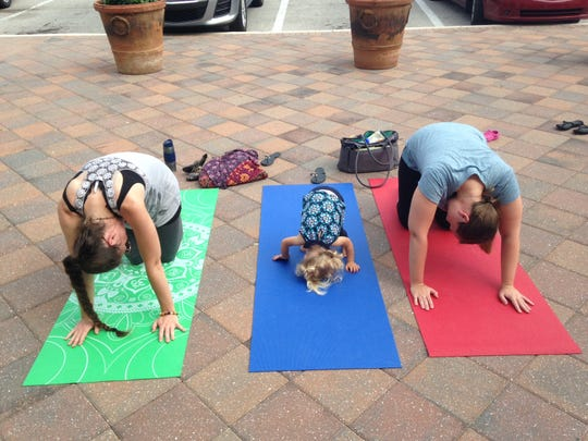 Family yoga class begins at 10 a.m. Saturday, June 15, in WINK Playland at Miromar Outlets.