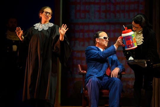 "Justice Ginsburg (Jennifer Zetlan) and Justice Scalia (Brian Cheney) in a fractious moment over the legality of  New York City's ban on ""Big Gulp"" cups in the OperaDelaware production."