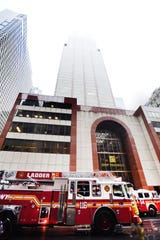 Firetrucks are seen outside of a building on 7th Avenue between 51st and 52nd Streets in NYC, where a helicopter reporterdly crash landed on the top of the building Monday afternoon, photographed on 06/10/19.