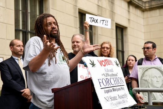 """Ed """"NJ Weedman Forchion of Trenton, speaks at a rally and press conference for the legalization of marijuana held by NORML outside of the NJ State House Annex in Trenton on Monday, June 10, 2019."""