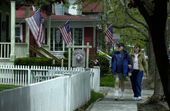 John and Beth Cline of Alaska walking past the Victorian homes on Hughes Street in Cape May in 2006.