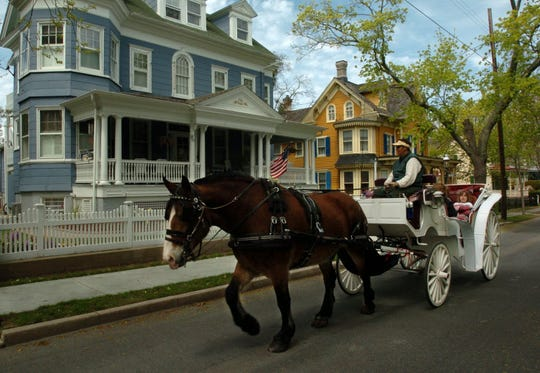 A horse drawn carriage passing the Victorian homes on Hughes Street in Cape May in 2006.