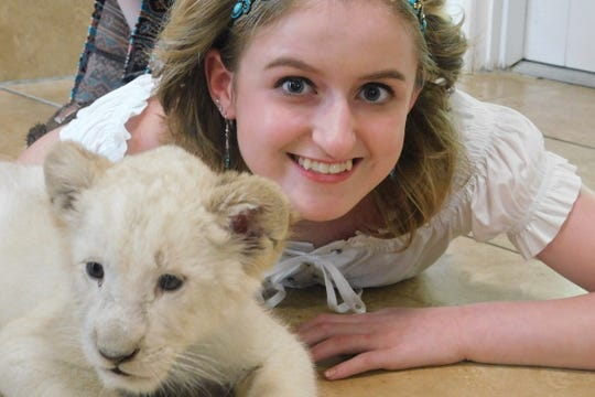 Emerson HS senior cheerleader Jessica Livingstone got to meet a baby white lion during a private trip to a nature reserve in Florida.